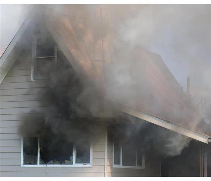 Smoke coming out of a home