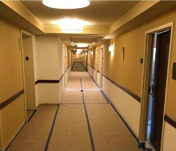 A hallway of a building cleanup after water damage