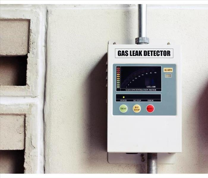 gas leak detector box on cement wall
